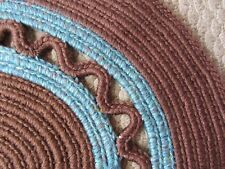 Handmade Crocheted round rug in Brown and Blues   >