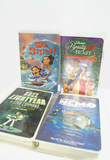 Lot of 4 Walt Disney Clamshell VHS -  Lilo & Stitch - Beauty & The Beast - Buzz