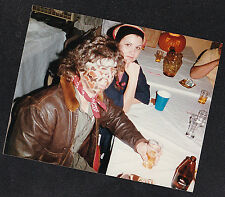 Vintage Photograph Woman Sitting With Man With Crazy Paint on Face Halloween?