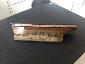 large heavy wooden hull , of a boat , around 18 inches , a good start