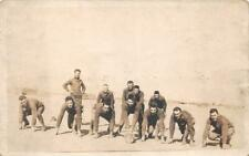 RPPC FOOTBALL TEAM CAMP PRACTICE REAL PHOTO POSTCARD (c. 1910)