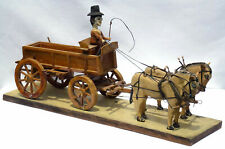 Detailed Folk Art carved assemblage of a man driving two horses and a wagon.