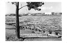 International Falls Minnesota~Sawmill Pulpwood in Rainy River~Bridge~c1950 RPPC
