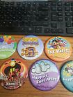 Disney pins /buttons 7 of them