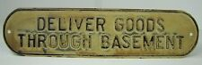 Old DELIVER GOODS THROUGH BASEMENT Sign embossed tin metal store advertising