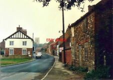 PHOTO  YORKSHIRE SEASIDE ROAD EASINGTON IN 1987 THE BUILDING ON THE IMMEDIATE RI