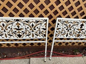 Antique pair of twin cast iron headboard beds
