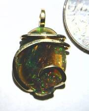 4.04ct Faceted Australian Crystal Opal in 14kt Gold Art Wrap Pendant