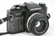 Olympus OM40 Program DX, vintage roll-film camera & lens Zuiko Auto-S 1.8/50mm.