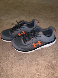 Under Armour athletic shoes size 6Y youth gray/orange
