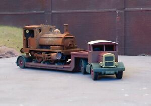 OO gauge Pug loco on a low loader, heavily rusted and weathered. Ref 2