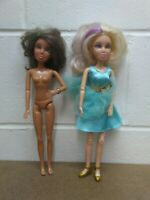 Spin Master pair of Liv Dolls with wigs. Blonde Hair w/Purple. Brunette w/Green