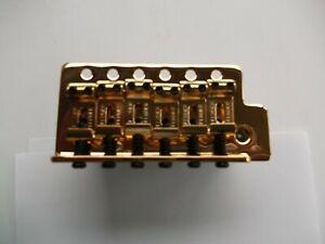 """Fender gold Tremolo Bridge 2"""" 1/16 Narrow Spacing std Block 005-9561-000"""