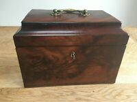 Antique mahogany tea caddy with storage compartments and key