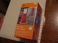 set of 4 RED CUP BED RISERS, 7 inch in box, VERY COOL