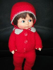Vintage Lorrie 16 inch Wetting rubber doll. with saran hair.