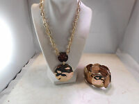 Dana Buchman Gold and Copper Toned Necklace and Bracelet set