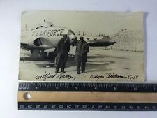 Vintage photo of 2 african american men standinging in front of air force plane
