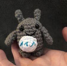 A Mini Crocheted Amigurumi Totoro Stuffed Toy