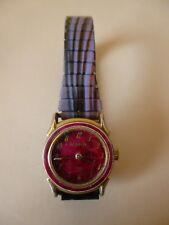 Ancienne petite montre femme mécanique dorée   LA PERLE   bracelet extensible