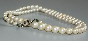 ANTIQUE ART DECO PEARL NECKLACE WITH 9CT WHITE GOLD NATURAL DIAMOND CLASP.