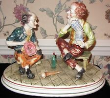 LARGE CAPODIMONTE ACCORDION PLAYER ON BENCH W MAN AND BOTTLE; SIGNED