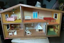 A VINTAGE LUNDBY OF SWEDEN DOLL HOUSE WITH FURNITURE. ELECTRICITY NOT WORKING
