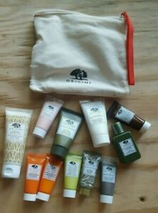 HUGE COTTON BAG OF ELEVEN ORIGINS TRAVEL SIZE LOTIONS AND POTIONS (brand new)!!
