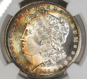 1885-P Morgan Dollar NGC MS65 Attractive Crescent Rainbow Toned Gem