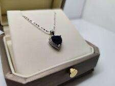White gold finish blue sapphire and created diamond heart pendant