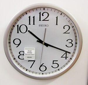 "SEIKO SILVER-TONE METALLIC  CASE  WALL CLOCK 12.25"" WITH QUIET SWEEP QXA711SLH"