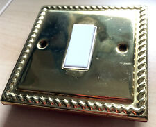 gold light switch with white button