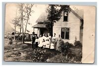Vintage 1910's RPPC Postcard - Family Photo Farm Home Horses & Wagon in Distance