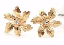 VINTAGE LADIES 14K YELLOW GOLD DIAMOND FLOWER EARRINGS WITH SCREW BACKS.