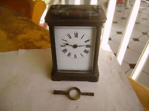 Lovely vintage brass/gilt metal carriage clock with key from 1960s.