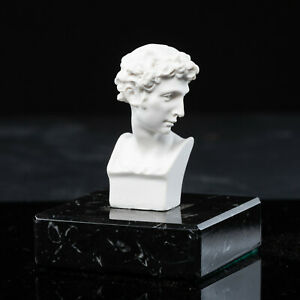 Sculpture of David after Micheangelo on a solid marble base. Art, Gift, Ornament