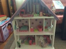 Wooden Girls Dolls House with furniture and family characters