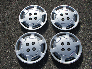 Genuine 1991 to 1995 Saturn S series bolt on 14 inch hubcaps wheel covers set