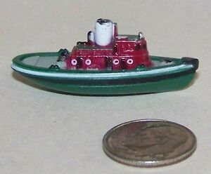 Small Micro Machine Plastic Tug Boat with a Green Hull