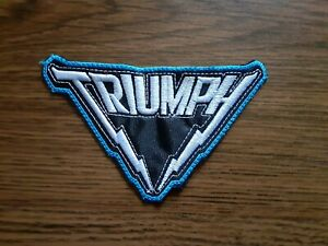 TRIUMPH,SEW ON WHITE WITH BLUE EDGE EMBROIDERED PATCH