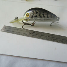 "FISHING LURE  RERBEL  2¾""   HUMPY  BLACK BACK & SILVER"