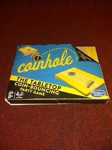 The Hasbro Coinhole Tabletop Coin-Bouncing Wooden Board Game never played