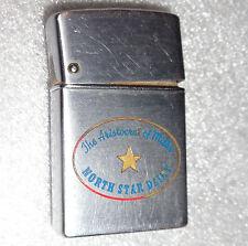 old steel case Brown & Bigelow lighter advertising North Star Dairy