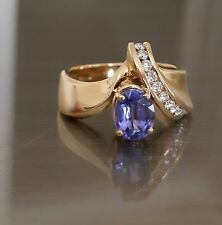 14kt YG (6.6 Grams) Oval Cut Tanzanite and Round Cut Diamond Ring