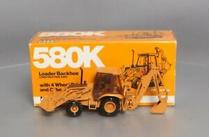 Conrad 2934 1:35 Case Loader/Backhoe With 4 Wheel Drive And Case 4-In-1 Bucket