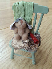 1/12th scale aged and distressed nursery chair with 'tatty pirate teddy'