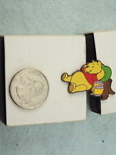 WILLABEE & WARD DISNEY PIN WINNIE THE POOH LAYING AGAINT TREE WITH HONEY POT