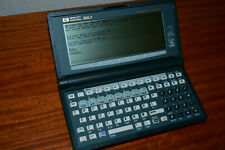 HP 200LX 1MB Palmtop w. Serial PC Cable and manuals