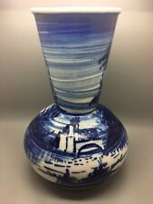 Old delft vase in a bulbous shape and flow blue decoration of a river and bridge