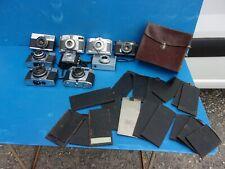 appareil photo ancien , lot de 9 + plaques dans etui cuir.